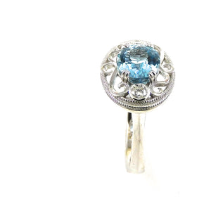 scrollwork, milgrain, and diamond accented mounting aquamarine center stone ring