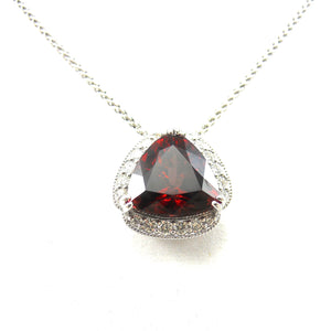 handcrafted Rhodolite garnet pendant in a diamond accented mounting