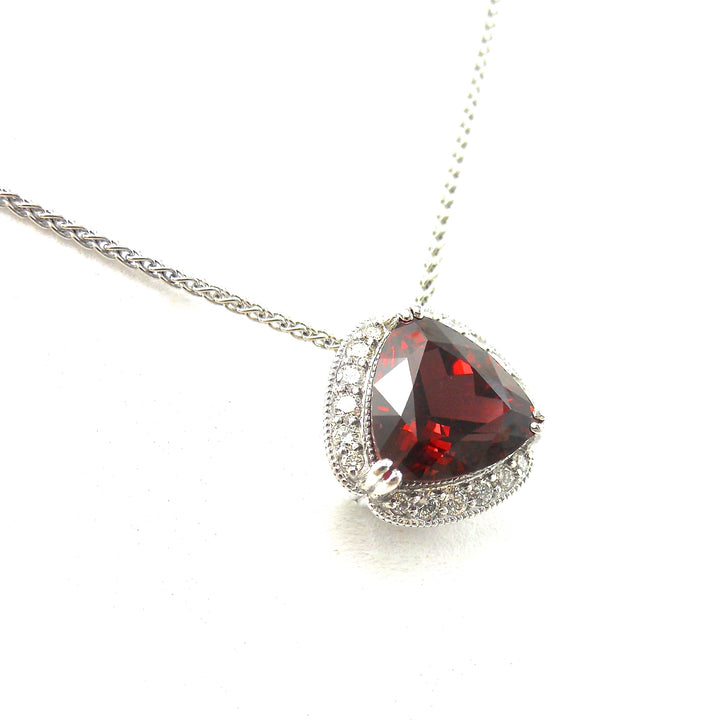 Rhodolite garnet pendant in a diamond accented mounting