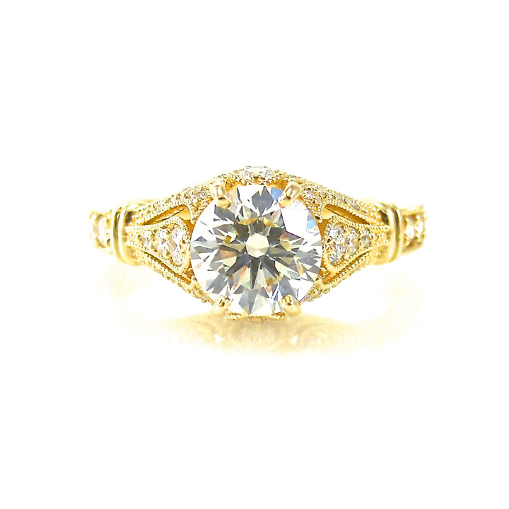 antique style solitaire engagement ring featuring filigree and diamond accents