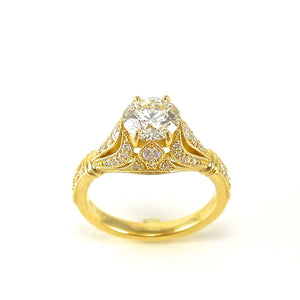 18k yellow gold antique style solitaire engagement ring featuring filigree and diamond accents