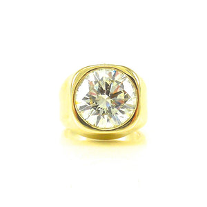 18k yellow gold setting with 8 carat center diamond stone