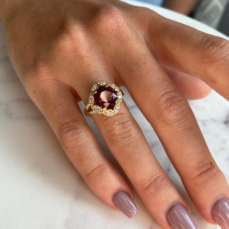 Rhodolite garnet center stone ring with diamond accents in an 18k yellow-gold mounting