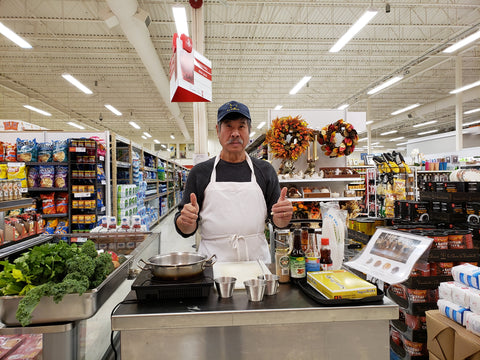 Super Tom in grocery store preparing for food demostration