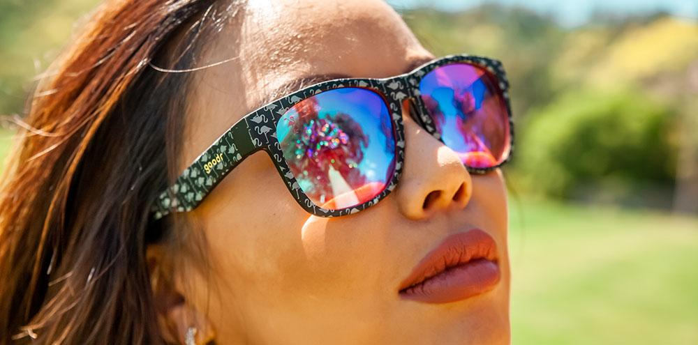Woman Wearing Goodr You Say Bogey, I Say Flamingo Golf Sunglasses