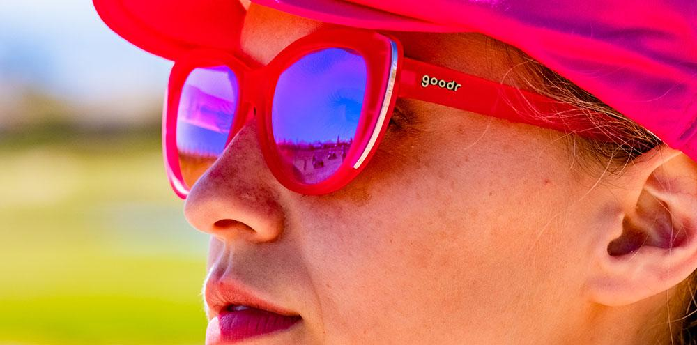 Woman wearing Goodr Sand Trap Queen Golf Sunglasses