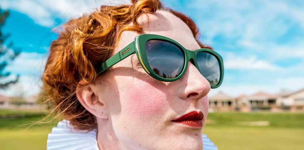 Queen Mary I wearing Goodr Mary Queen of Golf golf sunglasses
