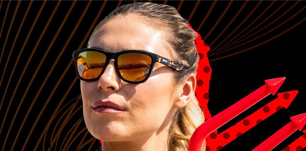 Woman wearing Goodr See you in Hell! Running Sunglasses