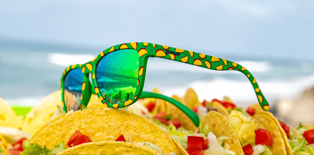 Goodr Hope They Serve Tacos in Hell Sunglasses resting on Tacos