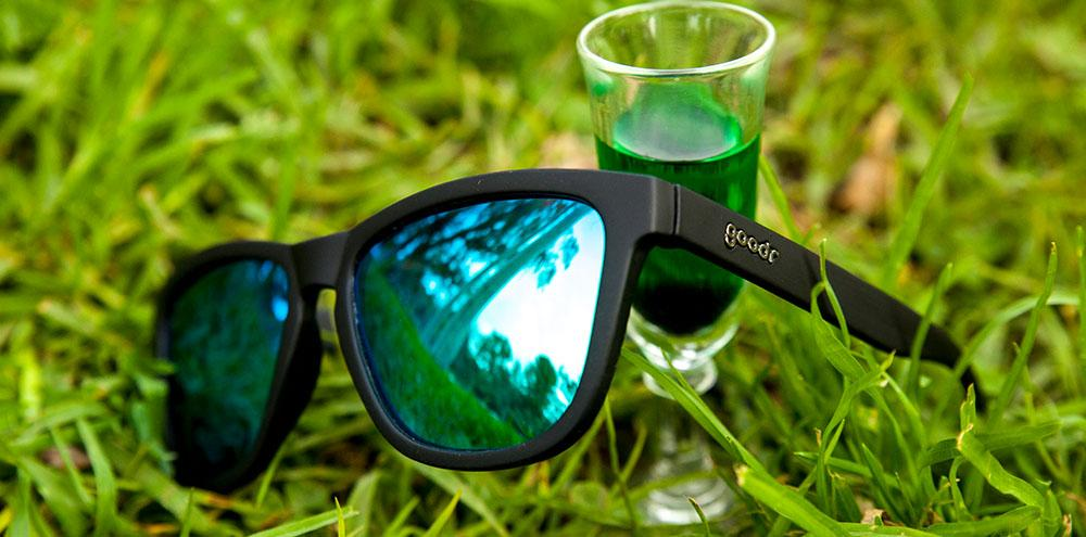 Goodr Black and Green Vincent's Absinthe Night Terrors Sitting on Grass