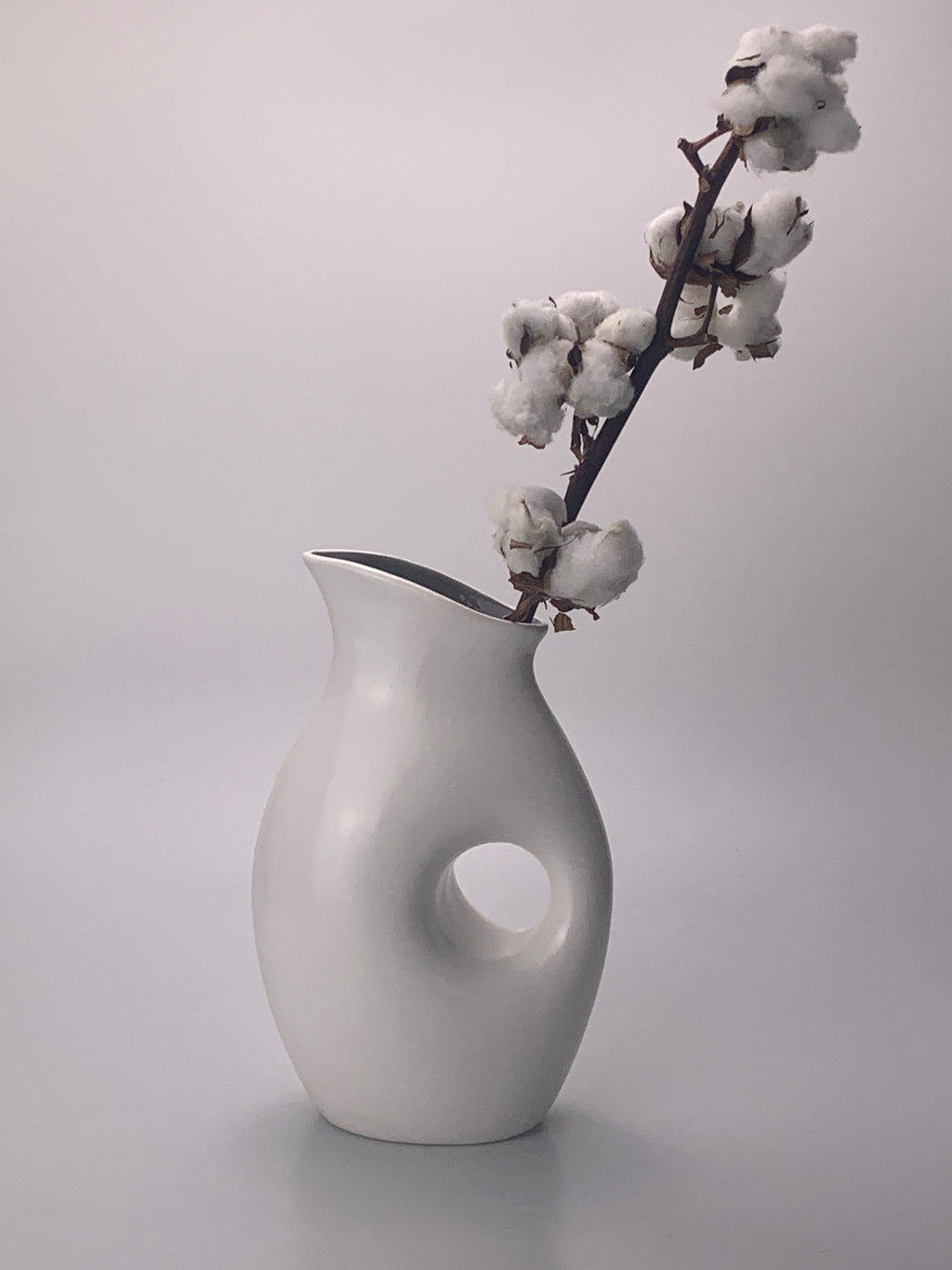 White and Grey Hole Vase