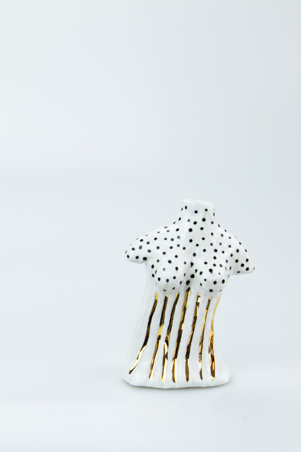 Black Spots and Gold Body Sculpture