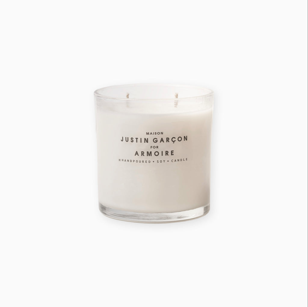 "ARMOIRE ""SCENTS THAT TRAVEL"" Candle."