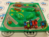 Mini ERTL Playset with 7 Trains. Some Pieces are Glued - Used