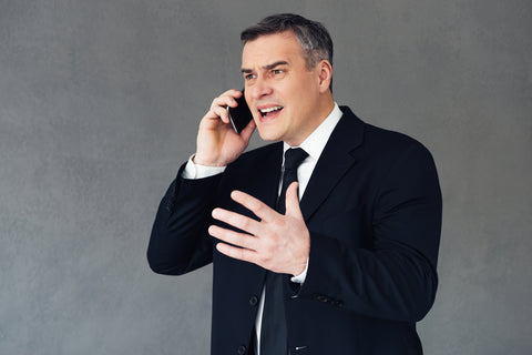Furious businessman with mobile phone
