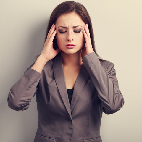Woman touching her head with headache