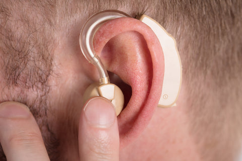 Close-up Of A Man Wearing Hearing Aid
