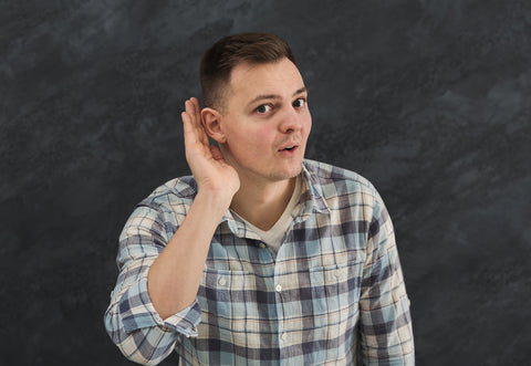 Young man trying to listen gossip