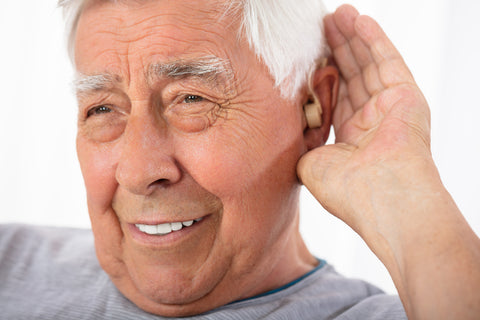 aged man with hearing aid