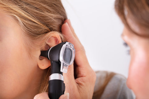 Doctor Checking Happy Girl's Ear With Otoscope
