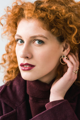 Close up of attractive curly redhead woman