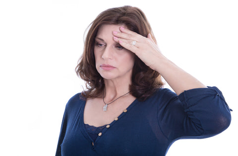 Desperate older isolated woman or headache
