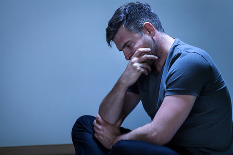 man mourning in pain