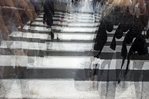 blurry image of people crossing a road