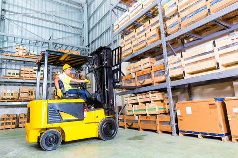 man driving yellow forklift