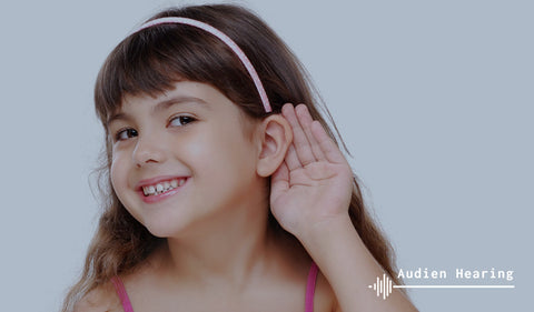 Image of young child trying to hear