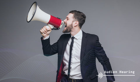 Image of man using speaker and producing loud sound