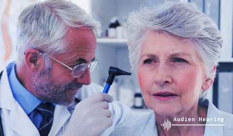 Image of audiologist performing ear exam