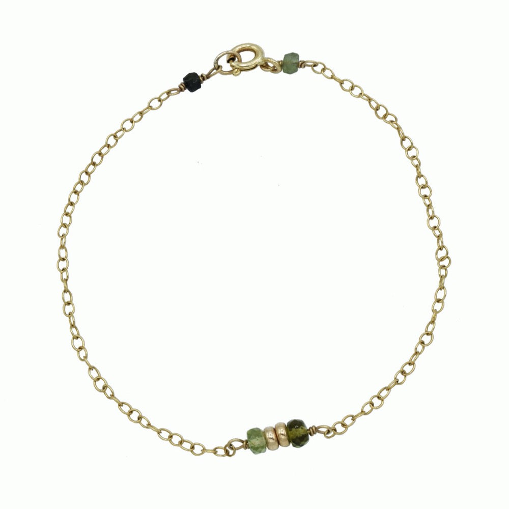 Gold bracelet with green tourmaline
