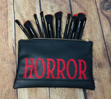 "Load image into Gallery viewer, Red Glitter ""Horror"" Cosmetic Bag"