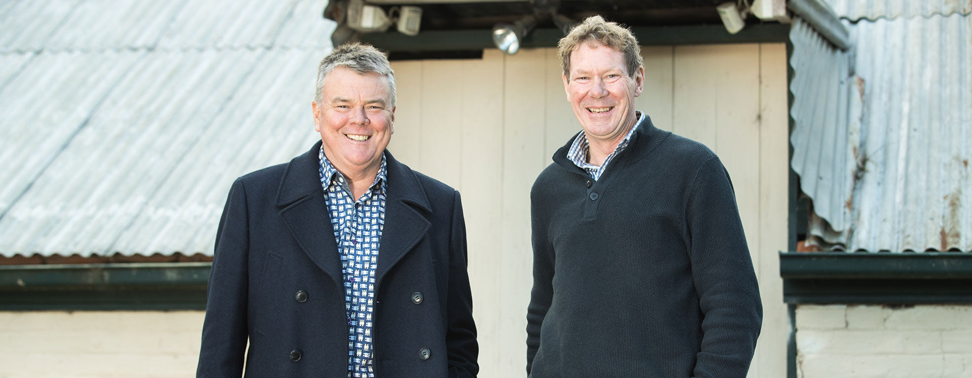 Winemakers David O'Leary (left) and Nick Walker stand side by side outside one of the old timber and iron sheds at the historic O'Leary Walker site in the Adelaide Hills.