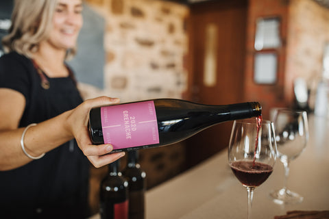 Cellar door manager pours a glass of our 2020 Grenache
