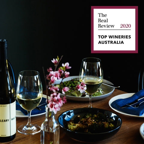 O'Leary Walker Wines Top Wineries of Australia 2020 award tile in top right hand corner, placed over shot of a dining time set with plates, flowers and two glasses of Riesling