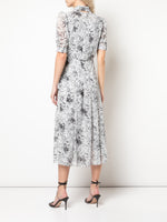 PLEATED BOW NECK DRESS IN PRINTED CHIFFON