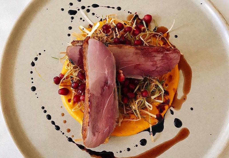 byblosmiami_smoked hawaii spiced duck breast with carrot foie gras puree, fried leeks and omegranate