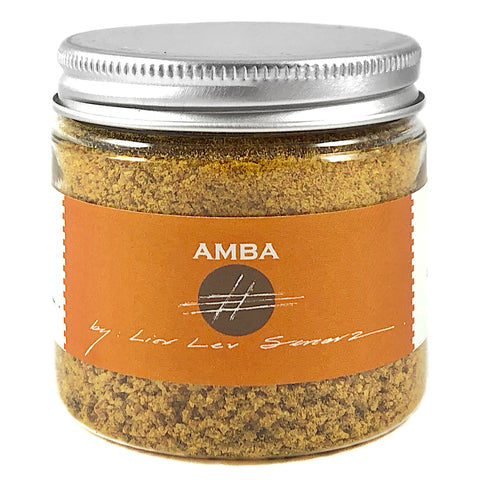 jar of turmeric and dried mango spice blend