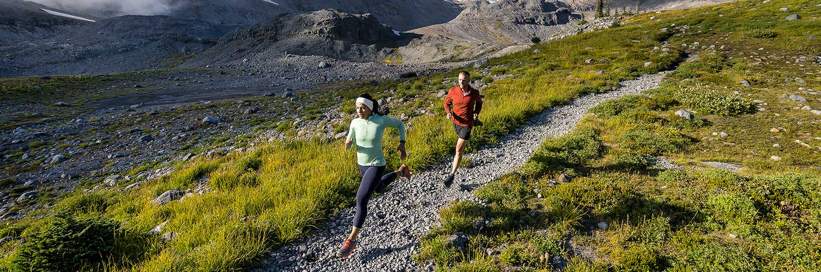 Man and Woman wearing Topo trail running shoes