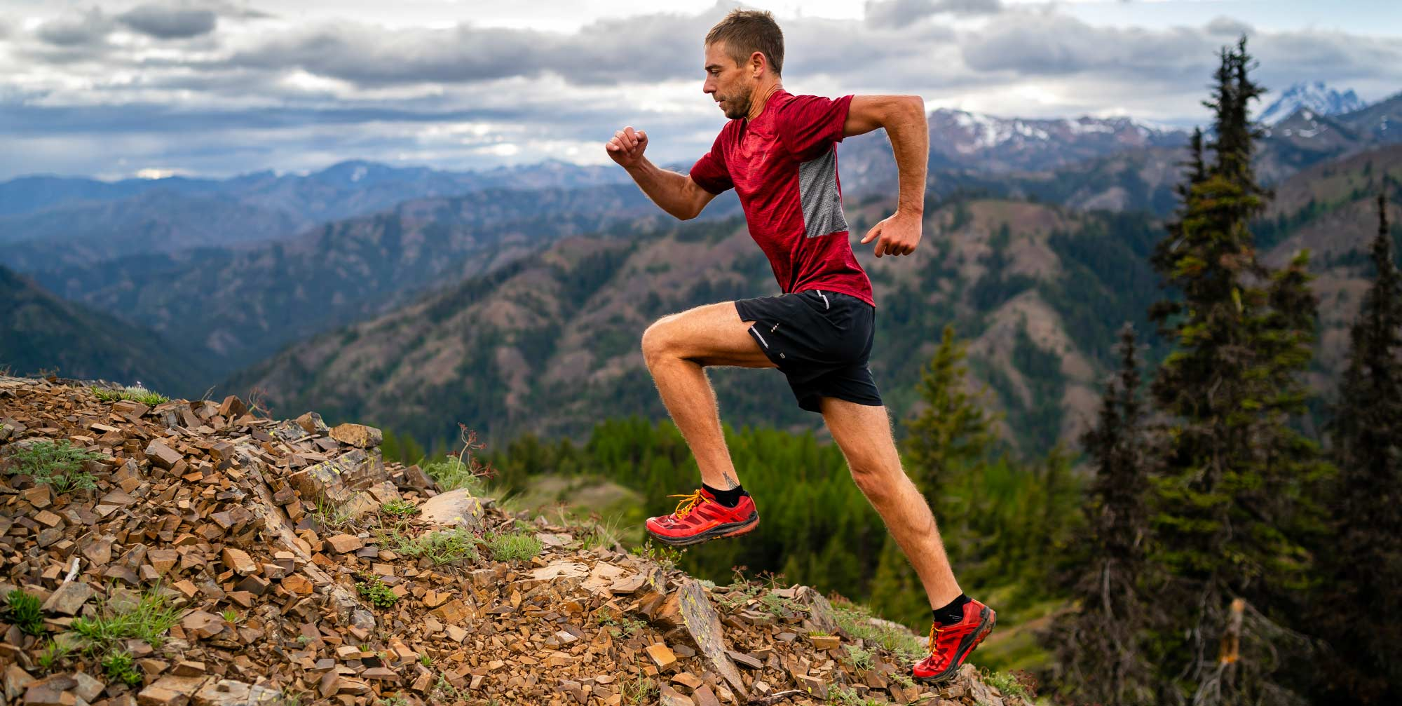 Charlie Ware Running up Mountain Slope wearing  Wearing Topo MTN Racer Tail Shoes