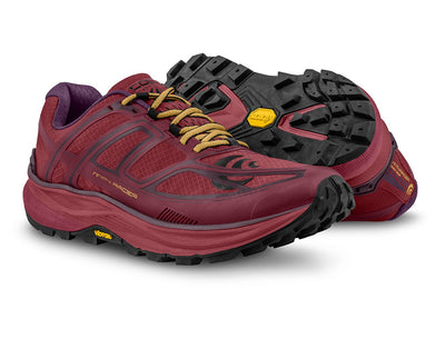 A pair of Topo MTN Racer Womens Trail Running Shoes in Berry/Gold