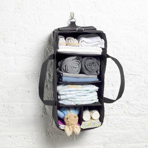 Storksak Travel Duffle Black hospital bag hanging organiser on hook filled | Maternity hospital bag | Storksak - Award-winning Baby Changing Bags & Accessories