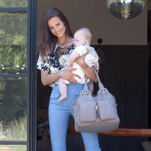 model wearing Alexa Taupe Baby Nappy Bag | shoulder bag Nappy Bag | Storksak – Award-winning Baby Nappy Bags & Accessories
