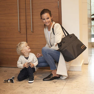 Model wearing Storksak Travel Expandable tote Black hospital bag | Maternity hospital bag | Storksak - Award-winning Baby Nappy Bags & Accessories