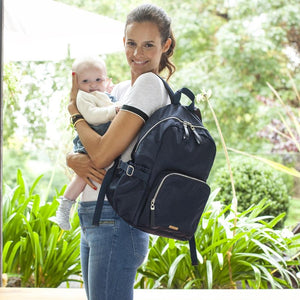 Model holding Storksak Hero Backpack Navy Nappy Bag | Backpack Nappy bag | Storksak - Award-winning Baby Nappy Bags & Accessories