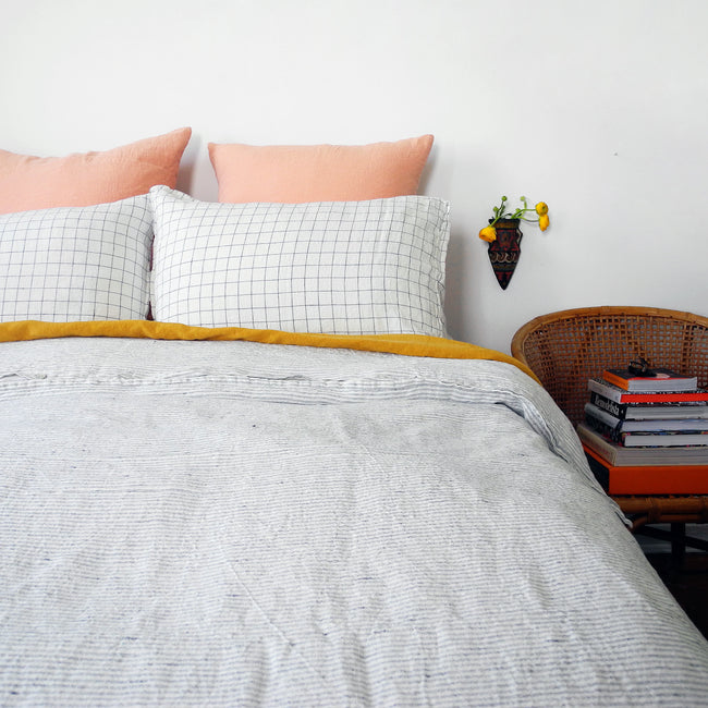 Linge Particulier Navy Check Standard Linen Pillowcase Sham with a stripe linen duvet and copper euro shams for a colorful linen bedding look in blue check - Collyer's Mansion