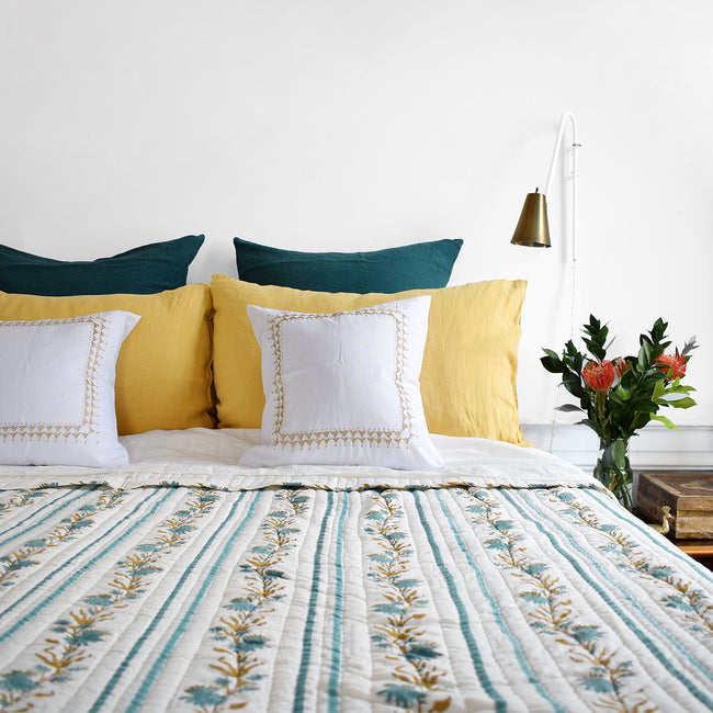 Linge Particulier Vintage Green Euro Linen Pillowcase Sham with a block printed quilt and gold pillowcases for a colorful linen bedding look in deep teal green - Collyer's Mansion