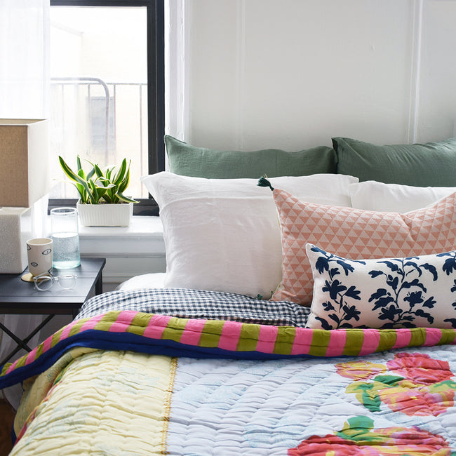 Linge Particulier Jade Green Euro Linen Pillowcase Sham with a Lisa Corti quilt and pink pillow for a colorful linen bedding look in camo green - Collyer's Mansion